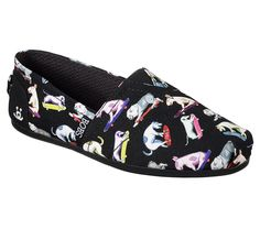 """The skate park meets the dog park in super fun and comfortable style in the Skechers BOBS for Dogs Bobs Plush - Wag Town shoe. Soft woven textile upper with colorful cartoon sketched skateboarding dogs print in a slip on casual comfort alpargata flat with Memory Foam insole. <br><b>BOBS helps make a difference for animals and kids - learn more <a href=""""https://www.skechers.com/en-us/bobs-for-dogs""""> here.</a></b>"""