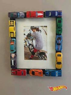 Matchbox hot wheels on a plain black picture frame.