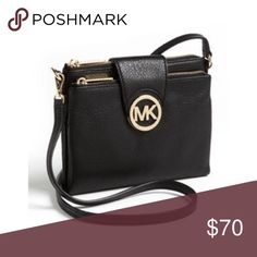 Michael Kors Wallet Cross Body Bag This is a two pocketed cross body bag with a flip over magnet latch, the middle of the two pockets act as a wallet with slots and a section for cash. Michael Kors Bags Crossbody Bags