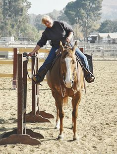 When working a gate, start with your horse parallel to it, reaching your gate leg toward the gate and holding the off leg on the horse.