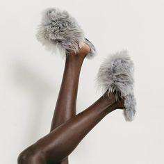 Alpaca slippers  They're designed in New York City, handmade in Peru, and 100 percent fair-trade Suri Alpaca.