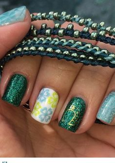 Gel polish and st. Patrick day stamped design also holding Bollywood 5 wrap bracelet in 3 shade of green