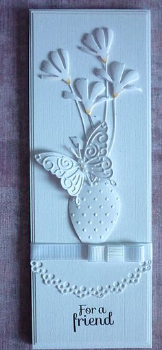 handmade card from A Scrapjourney: Pimp ... white on white ... tall and thin format ... delightful arrangement of die cut flowers, butterfly and vase ... fantastic card!!