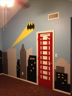 My sons new superhero room with Batman light signal