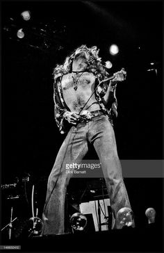 Robert Plant from rock group Led Zeppelin performs live on stage at Earls Court in London on 24th May 1975.