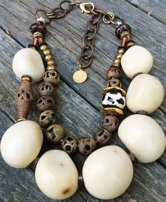 White Tagua: Exotic Organic White Tagua Nut, African Brass, Kenyan Giraffe Bone, Leather and Mixed Metals Necklace $225