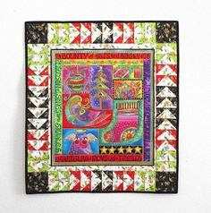 Yes, Christmas already.  I love Christmas décor!  Laurel Burch Christmas Wall Hanging Quilt by QuiltSewPieceful