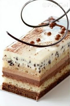 Three Chocolates Entremet  Clear glaze with cocoa powder and gold powder