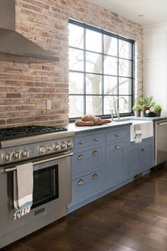 famhouse kitchen with brick wall | use arrow keys to view more kitchens swipe photo to view more kitchens
