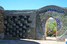 Bottle Wall Construction | ... walls of an Earthship made from recycled tires and colorful bottles