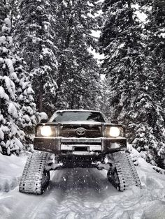 Toyota Tacoma on snow tracks. If you don't think this looks like fun, you need to reevaluate your life. Toyota Trucks, Toyota Cars, Toyota Tundra, Toyota 4runner, 4x4 Trucks, Toyota Tacoma, Cool Trucks, Truck Mods, Tacoma 4x4