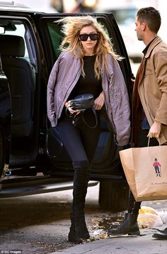 That's helpful: Gigi's driver carried a bag from The Bowery Hotel as she arrived at her Manhattan home