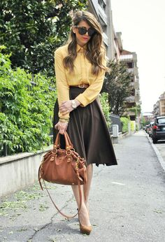 The yellow blouse adds a perfect pop of color to the other neutral colors in this outfit. Office Look.