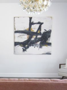 huge square canvas on sale for $40 at Michaels and used her son's oil painting kit to do her own version of this Franz Kline painting.
