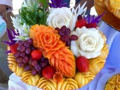 Veggie and fruit art and carvings make great centerpieces. New Years holiday centerpiece or a Christmas centerpieces for a dinner table for all...