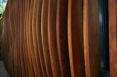 Coated steel frame, redwood planks, profile cut outs by CNC machines