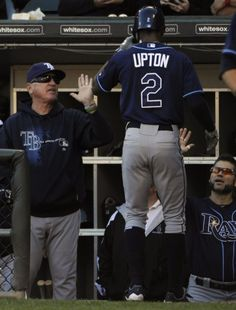 B.J. Upton #2 of the Tampa Bay Rays is greeted by manager Joe Maddon #70 after hitting a home run in the ninth inning against the Chicago White Sox on September 30, 2012
