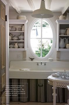 Pretty vintage kitchen sink with oval window &  just switch up the things in the shelves and it would make this an upscale Mud room.