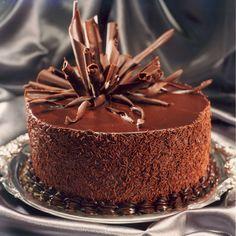 ** Dark chocolate cake decorated with chocolate curls.