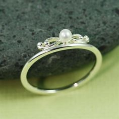 Silver Floral Pearl Ring.  So petite and I love pearls.