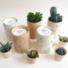 Splatter planters and hand poured soy wax candles.  The splatter effect is so fun to do - each pot will come out slightly differently, and its great to watch it develop right before your eyes.