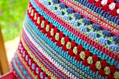 colorful crochet pillow. I'd like this sort of pattern in a blanket style