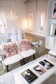I ♥ sooo many things about this room..formal chairs, lovely pillows, fashion books on the coffee table, and mirrored tables!
