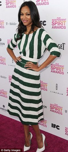 Star in stripes: Zoe Saldana arrived in a dark green and white midi dress with white shoes