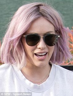 Shades of deep purple: Hilary Duff had her faded locks died platinum blonde before opting to go lilac in West Hollywood on Wednesday