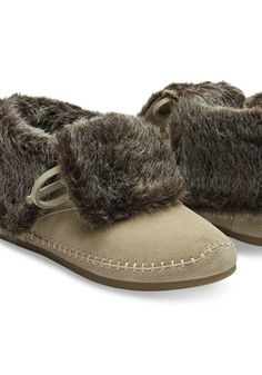 Softly structured, these adorable suede booties are lined with faux shearling and feature a fold over top for a laid-back look.