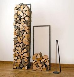 Indoor Firewood Storage - Simple, square metal frame using square conduit; painted black; looks easy to make with a welder, or could use plumbing conduit.