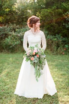 I was very inspired by Bella's dress in the movie Breaking Dawn. I found a gown with the most amazing lace long sleeves from the 1950's. And to make it even better, it was only $25!  Pics: Lyndsey Paige Photography http://www.confettidaydreams.com/backyard-bohemian-campground-wedding/