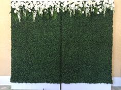 Boxwood backdrop with dripping flowers.