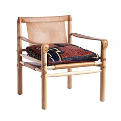 gorgeous leather campaign style chair with vintage rug cushion