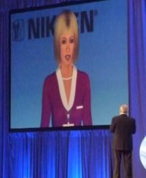"""An unusually attractive spokesmodel appeared on big screens for the Nikken network marketing event at the Anaheim Convention Center and created some great impressions. With Kira Gurnée, professional model, as the voice of """"Julie"""" and Gary Jesch at the Digital Puppeteer controls, this CMS Communications production brought nothing but praise from Nikken event managers."""