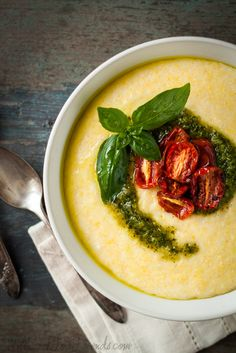 Creamy Cheesy Polenta with Basil Pesto and Oven-Roasted Tomatoes.