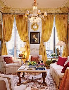Timothy Corrigan united French elegance with American comfort in a California client's Parisian pied-à-terre.The living room has an 18th-century bronze gueridon, from Sotheby's. Christie's carpet and chandelier. Drapery and cut-silk pillow fabrics, Clarence House. Rogers & Goffigon linen on chair in foreground.