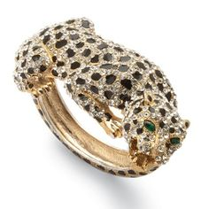 @Overstock - This Lillith Star bangle bracelet features a detailed animal print design encrusted with white and green crystals in round and marquise cuts. This bracelet is rendered in 14-karat yellow gold overlay with a high polish and includes a hinge for easy wear.http://www.overstock.com/Jewelry-Watches/Lillith-Star-14k-Goldplated-Crystal-Leopard-Hinged-Bangle-Bracelet/7377778/product.html?CID=214117 $35.62