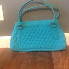 Microfiber Vera Bradley Handbag I love this bag but it just sits in my closet. I hate to see it not used. Beautiful blue color with green interior. One exterior pocket. Normal wear but no major flaws. Good condition Vera Bradley Bags Shoulder Bags