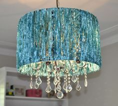 Gina at A Sense of Design changed up her chandelier with a little fluffy turquoise yarn.