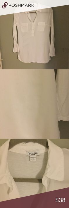 Splendid Pocket Tee White long sleeve pocket tee by splendid. Button sleeves to wear rolled up or down. Preowned condition with some signs of wear. There is a faint scuff in second photo. I think this should come out. Color is bright white with no fading. Classic white top that has been a Splendid staple year after year and is currently selling at Nordstrom. Feel free to ask questions! Splendid Tops