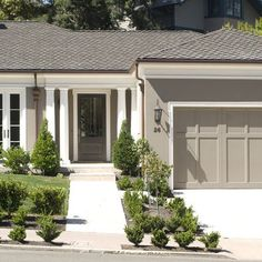 white trim and grey stucco. garage door painted the body color & trimmed out in white.