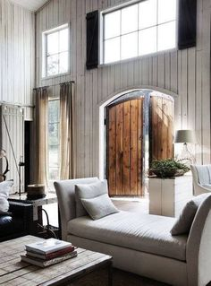 White interior / contrast with wooden door / dramatic entrance
