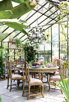 A glass greenhouse turned into a eclectic dining room. Just lovely! For the 40th Annual Atlanta Decorator's Show. Source: Atlanta Homes & Lifestyles Photographer: Erica George Dines