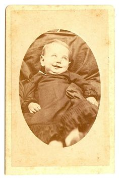Victorian Post mortem Kind of creepy w/ a smile & blank eyes. Still very sad to see this small child has died.