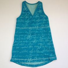 Lululemon Tank Top Lululemon tank top. Turquoise blue with allover cursive writing print. Has bra shelf. Size 4. No trades. lululemon athletica Tops Tank Tops