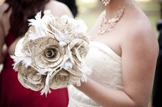 Bouquet made out of 100-year-old sheet music, feathers, lace, tulle, floral wire, and floral tape.