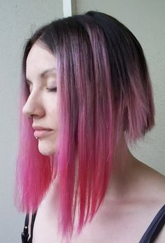 dramatic bob with short layers in the back and pink ends