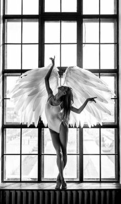 A fashion black and white wall art with the breath of the sun penetrating through big frosted window, back-liting an angel-like bellerina dancing with white feather wings and white leotards. Angels Among Us, Angels And Demons, Vs Angels, Fantasy Kunst, Fantasy Art, Ange Demon, Angel And Devil, Foto Art, Victoria Secret Angels