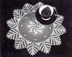 Feeling ambitiously, tediously brave?  LOL!  This doily (Doily Number 7318) was originally published by Clark's O.N.T. in Old and New Favorites Doilies Book, Number 217, in 1944.  Doily measures 11 inches in diameter using size 70 cotton thread and a size 13 steel hook....WOW!  Sewing machine thread is size 80.  That is very small thread!  -Lee Ann Hamm (http://cgli.us)